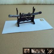 Japanese Samurai desk top letter opener and stand.